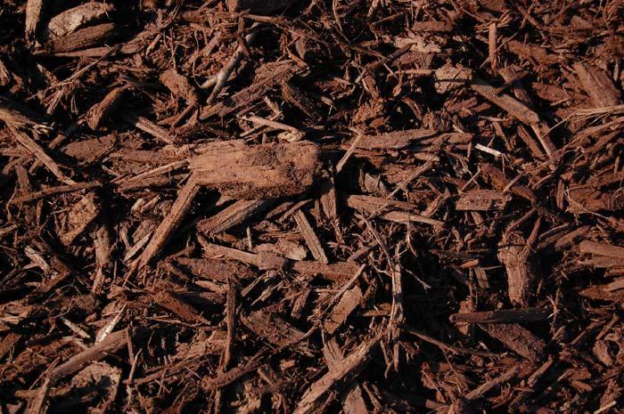 Chocolate mulch mulch lawn garden niemeyer 39 s for Dark brown landscape rock