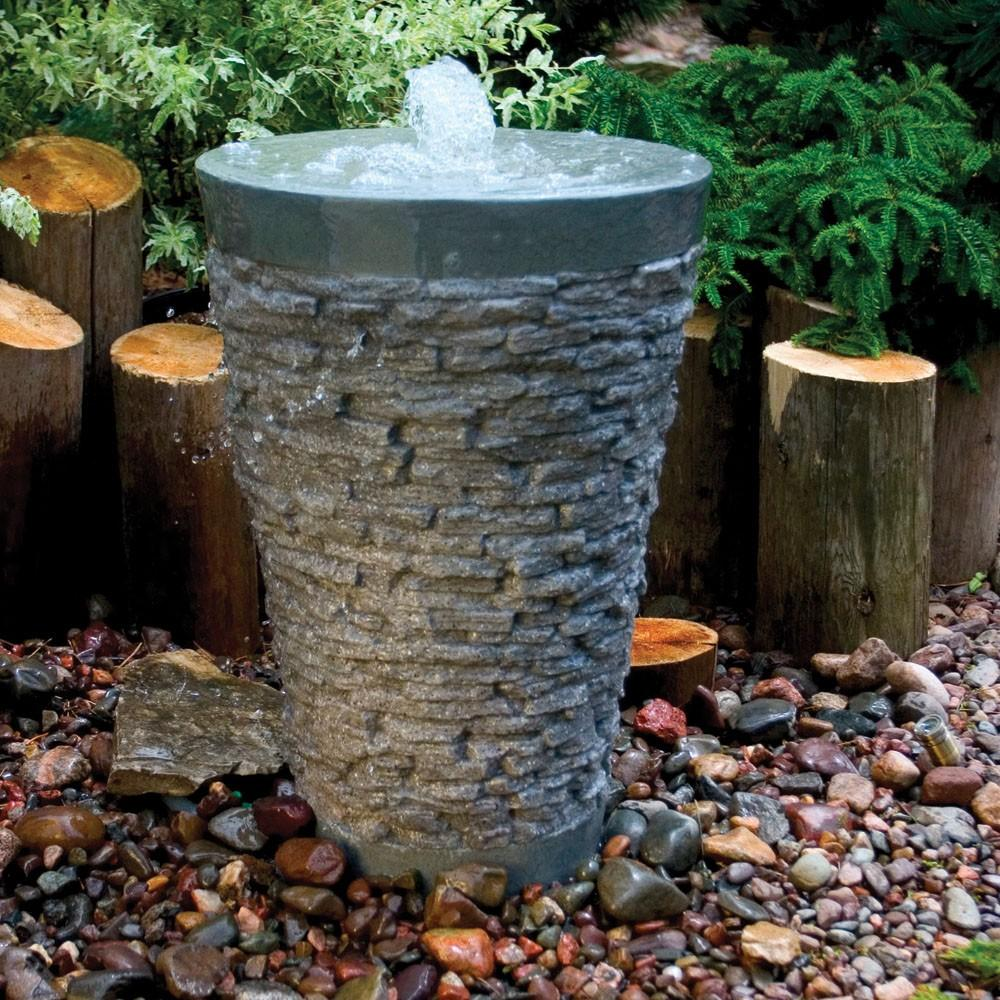 Stacked slate fountain fountain fiberglass stone for Garden fountains and water features